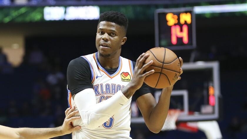 Oklahoma City Thunder's Justin Patton looks to pass the ball during a preseason NBA basketball game.