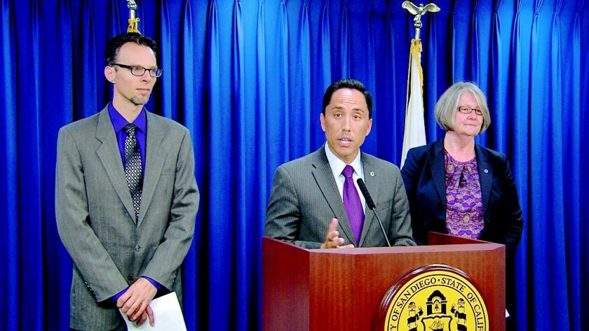Todd Gloria made a proposal today at City Hall to raise the minimum wage to $13.09 per hour. From left to right, Peter Brownell, research director for the Center on Policy Iniatives. Todd Gloria, Co