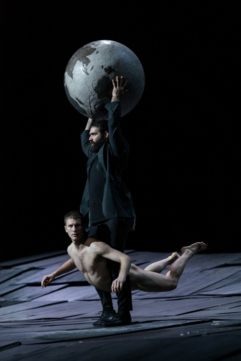 "Yorgos Tsiantoulas with the globe, and Ioannis Michos in ""The Great Tamer"" at UCLA's Royce Hall."