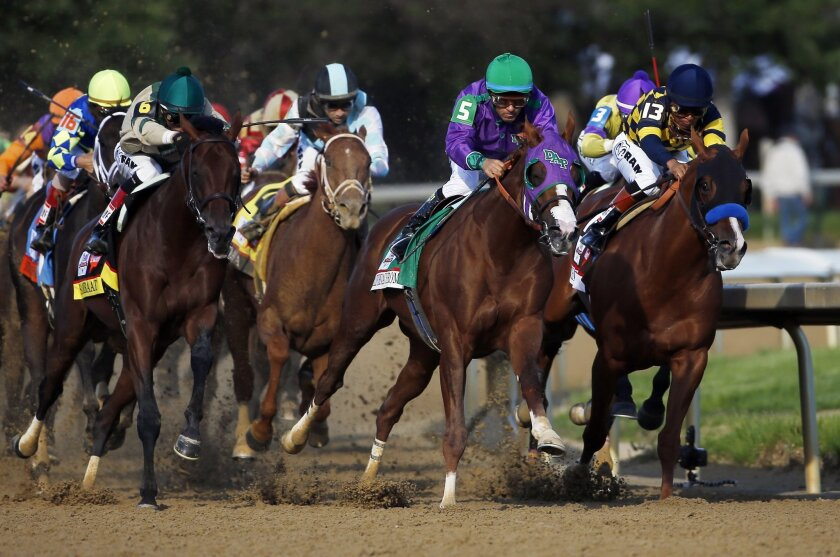 FILE - In this May 3, 2014 file photo, Victor Espinoza rides California Chrome around turn four to a victory during the 140th running of the Kentucky Derby horse race at Churchill Downs in Louisville, Ky. (AP Photo/Matt Slocum, File)