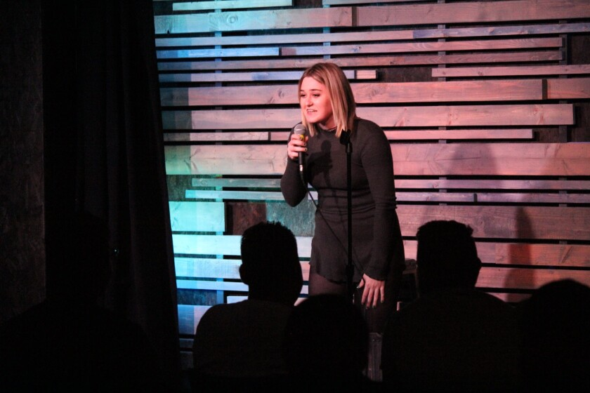 Comedian Ashley Kelly works at the Rec Room Comedy Club, where she both bartends and organizes comedy nights.