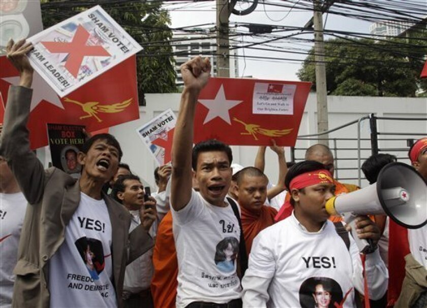 Myanmar activists holding placards take part in a protest in front of the Myanmar Embassy in Bangkok on Friday Nov. 5, 2010. They demanded Myanmar's military rulers to abolish the November 7 elections and release all political prisoners. (AP Photo/Sakchai Lalit)