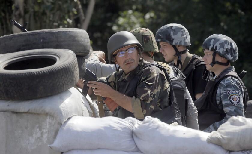 Ukrainian soldiers behind their barricade near the separatist-held town of Slovyansk in eastern Ukraine on Wednesday.
