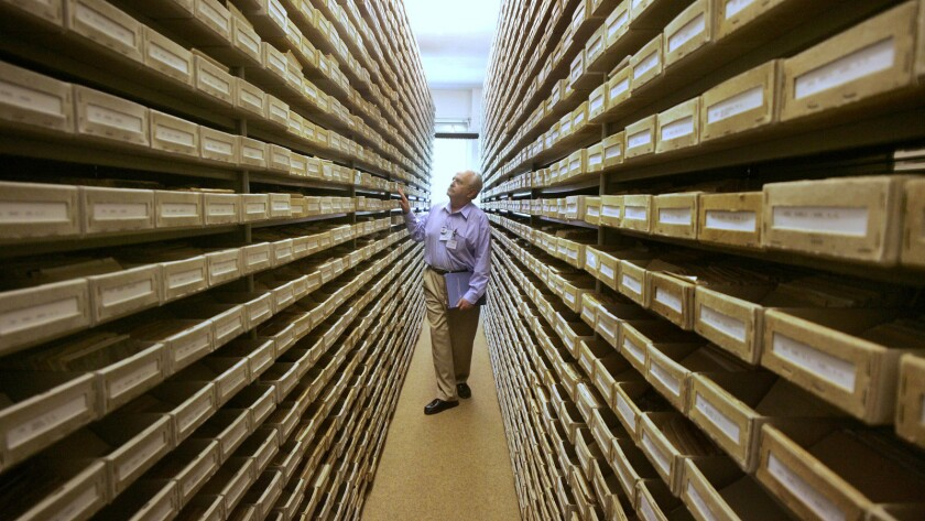 Gary Mokotoff, a Jewish genealogist from New Jersey, takes a look at name registers at the International Tracing Service in Bad Arolsen, central Germany, in 2008.