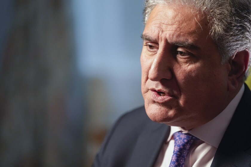 Pakistan's Foreign Minister Shah Mehmood Qureshi speaks during an interview with The Associated Press, Wednesday, Sept. 22, 2021, in New York. (AP Photo/Mary Altaffer)