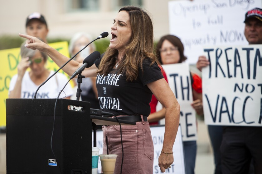 ReOpen San Diego co-founder Amy Reichert speaks at a demonstration at the County Administration building.