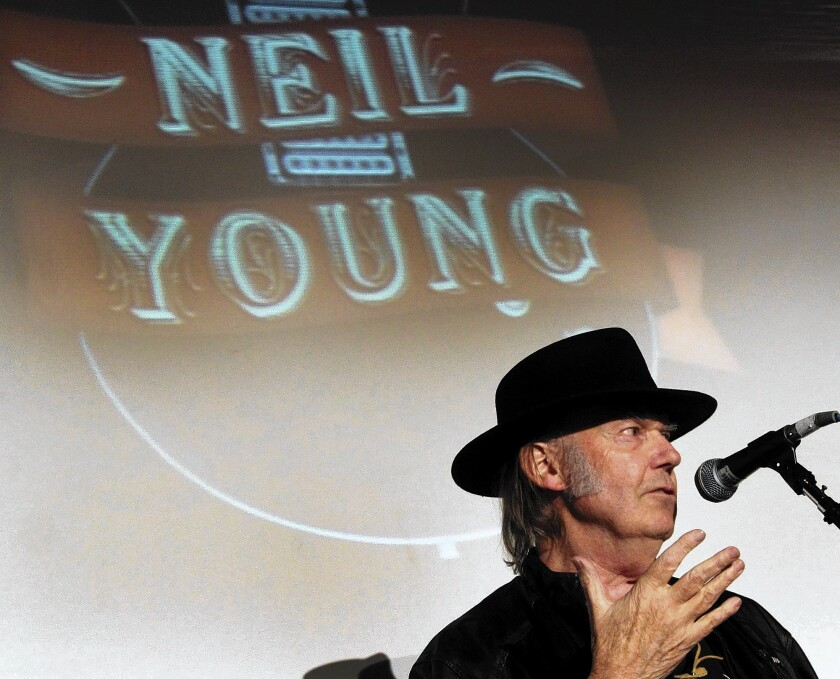 Grammy Producers & Engineers honor Neil Young with President's Merit Award, and he regales them with history of 'Like a Hurricane'