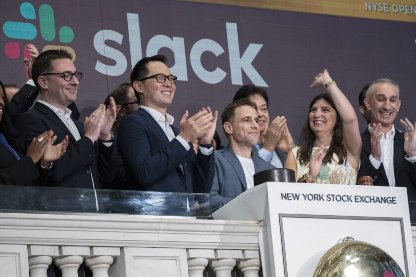 Slack executives ring the opening bell at the New York Stock Exchange on June 20, 2019.