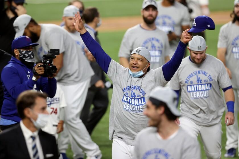 Manager Dave Roberts celebrates Sunday night after Dodgers won NLCS in Arlington, Texas.