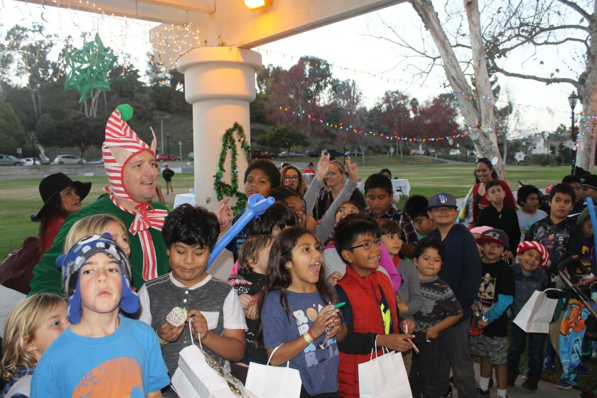 Local children enjoying the Del Mar Rotary Christmas Party.