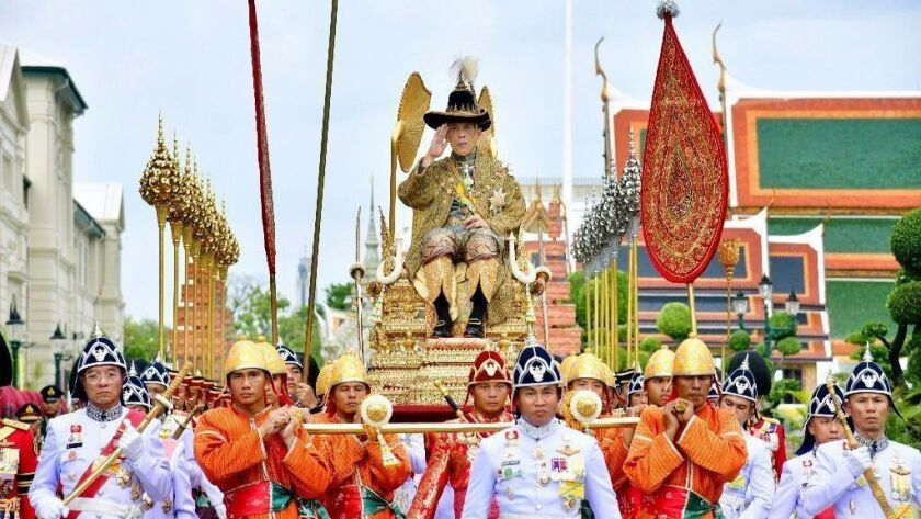 Thailand's King Maha Vajiralongkorn is transported on a palanquin by royal bearers as part of coronation ceremonies in Bangkok on Saturday.