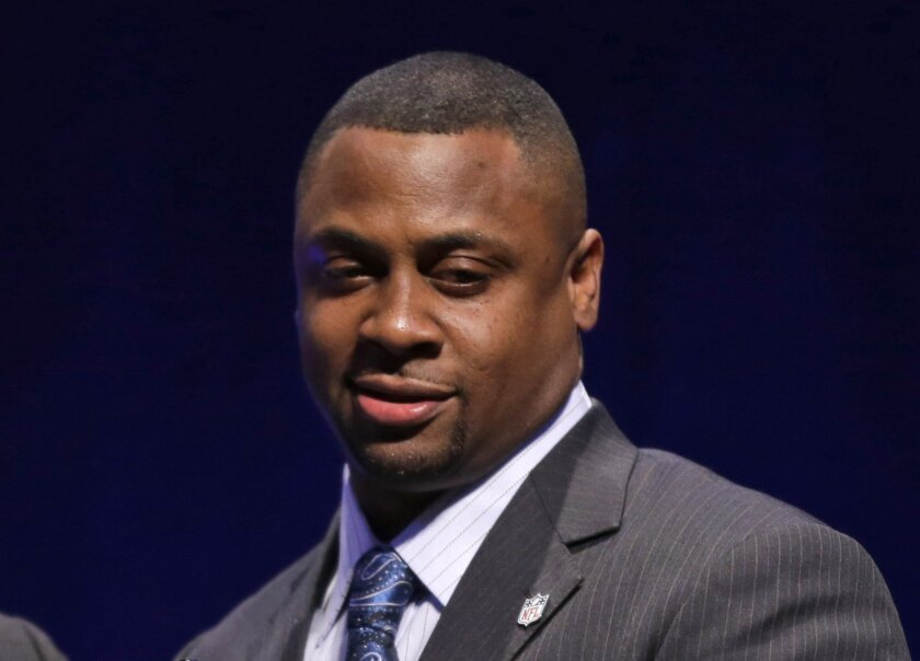 FILE - In this Jan. 31, 2014, file photo, NFL's head of football operations Troy Vincent reacts in New York. Vincent recognizes that trends always will be a part of the sport. (AP Photo/Matt Slocum, File)
