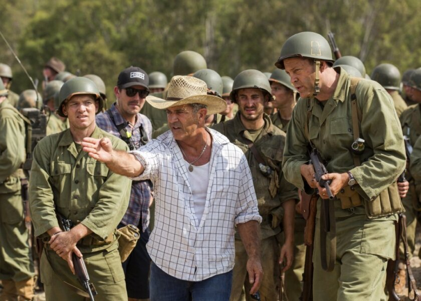 "Director Mel Gibson, center, and actor Vince Vaughn on the set of the film, ""Hacksaw Ridge."""