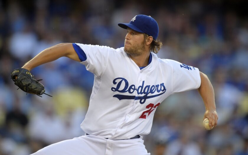 Los Angeles Dodgers starting pitcher Clayton Kershaw throws to the plate during the first inning of a baseball game against the Atlanta Braves, Thursday, July 31, 2014, in Los Angeles. (AP Photo/Mark J. Terrill)