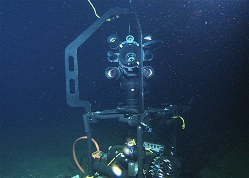 """In this photo provided by the Monterey Bay Aquarium Research Institute (MBARI), the 502-pound deep sea video camera """"Eye-in-the-Sea"""" sits on the floor of the Pacific Ocean 22 miles off the California coast Wednesday, Jan. 21, 2009. The Eye-in-the-Sea is the world's first Web camera that will offer a window into the darkness of the deep ocean. This camera and other novel experiments are possible because of a new deep sea observatory called MARS, which stand for Monterey Accelerated Research Station, the only operational deep sea observatory in the U.S.(AP Photo/MBARI)"""