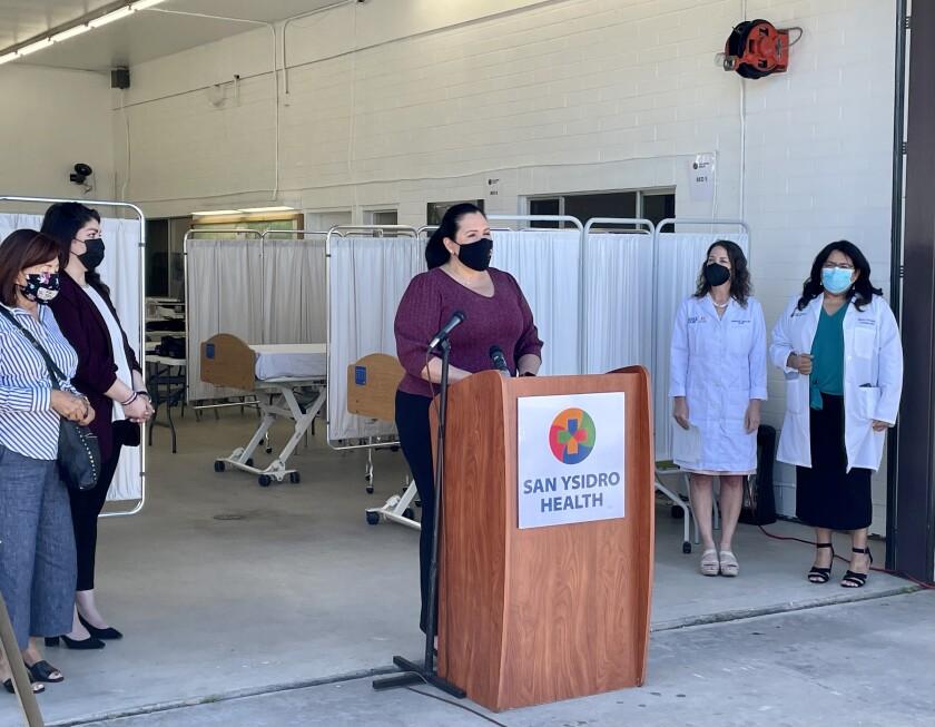 Supervisor Nora Vargas (center) with Chula Vista, County and San Ysidro Health officials