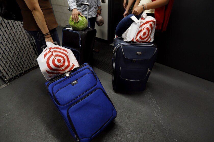 HOLLYWOOD, CA July 17, 2018: A family from Mexico gets on the elevator with their luggage for the