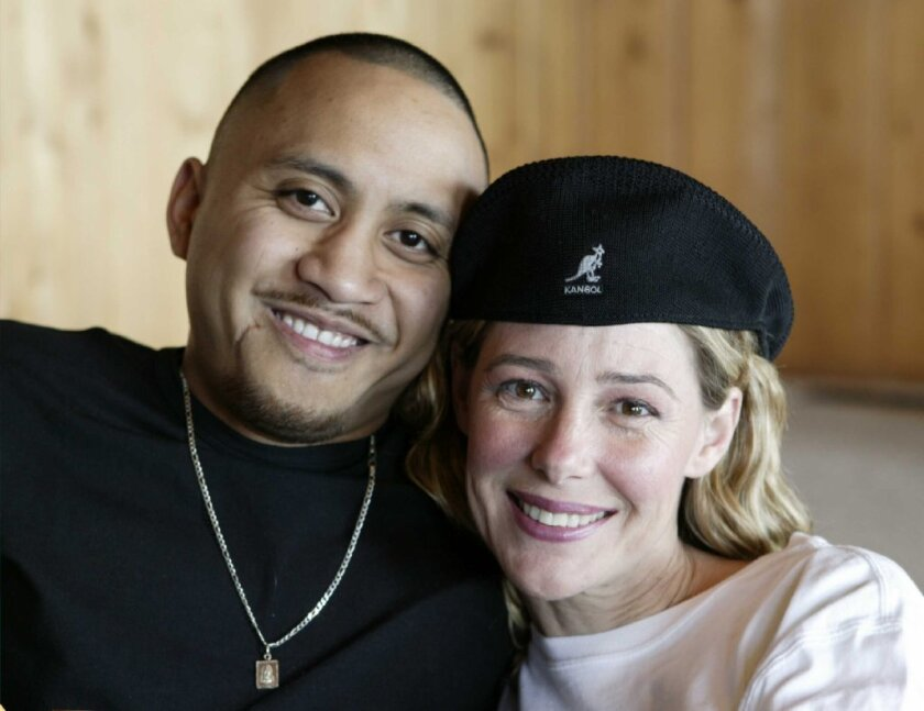 Mary Kay Letourneau and Villi Fualaau posing Saturday, April 9, 2005, in their home in the Puget Sound area of Seattle.