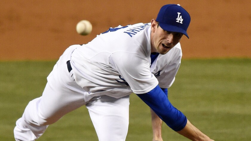 Dodgers starter Brandon McCarthy delivers a pitch during the second inning of a 6-5 win over the Seattle Mariners on Monday.