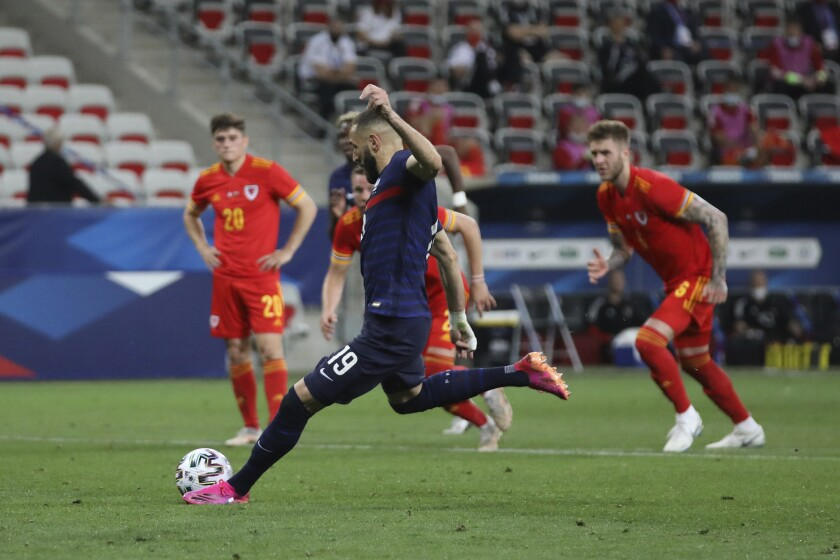 France's Karim Benzema misses a penalty shot during the international friendly soccer match between France and Wales at the Allianz Riviera stadium in Nice, France, Wednesday, June 2, 2021. (AP Photo/Daniel Cole)