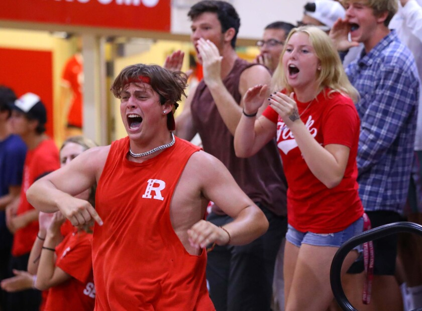 A Redondo girls' volleyball fan reacts after the Sea Hawks won a point during a match earlier this season.