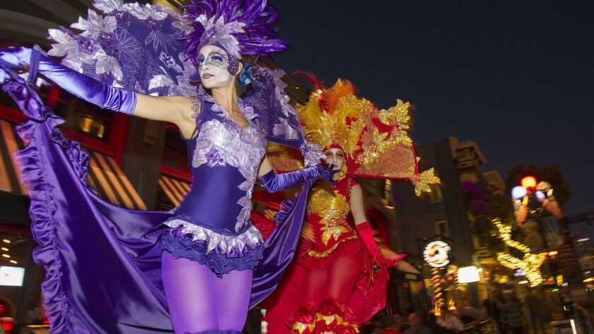 The 21st annual Mardi Gras in the Gaslamp took place Tuesday night. Bands, dancers, performers, and party goers swamped 5th Avenue looking for a good time. Performers R to L Tracey and Adelaide w