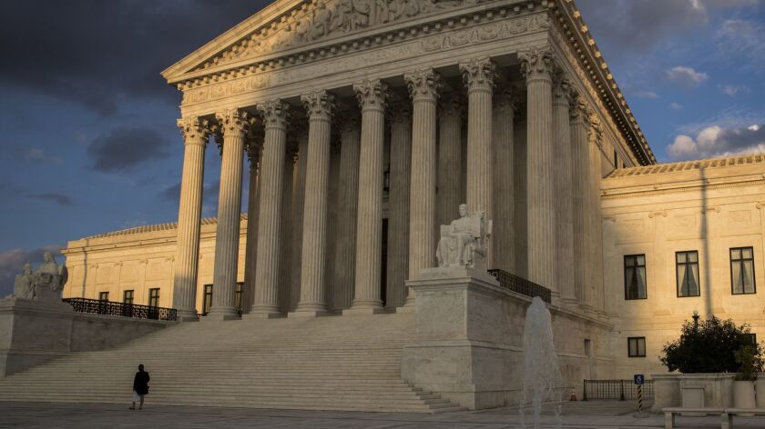 In this Oct. 10, 2017 photo, the Supreme Court in Washington is seen at sunset. The Supreme Court s