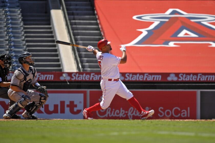 Angels slugger Albert Pujols hits a grand slam against the Houston Astros.