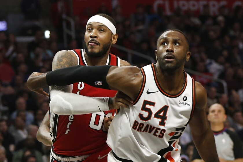 Clippers' Patrick Patterson guards Portland forward Carmelo Anthony on Dec. 3.