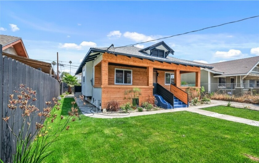 This wood-covered bungalow in Vermont Square is one of many L.A. homes on the market for around $500,000.