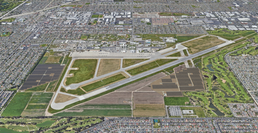 An aerial rendering shows proposed fields of solar panels on both sides of Los Alamitos Army Airfield.