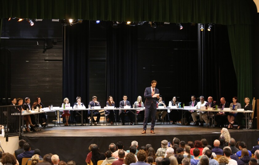 Most of the 24 candidates for the 34th Congressional District appear at a forum in Eagle Rock on March 22.