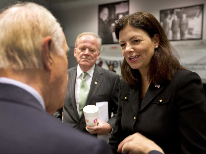 Sen. Kelly Ayotte, R-N.H., meets with area business leaders at Saint Anselm College before giving a speech at the New Hampshire Institute of Politics Monday, July 11, 2016, in Manchester, N.H.