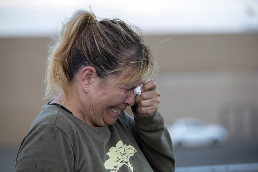 Edie Hallberg, crying, whose mother was killed in the El Paso shooting