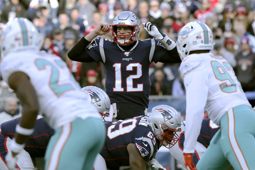 Patriots quarterback Tom Brady calls out signals at the line of scrimmage during a game against the Dolphins on Dec. 29.