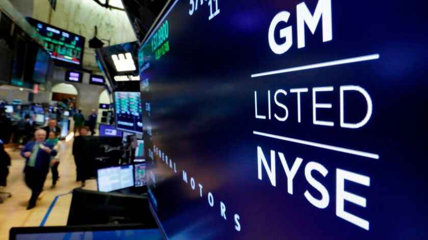The logo for General Motors appears above a trading post on the floor of the New York Stock Exchange this year.