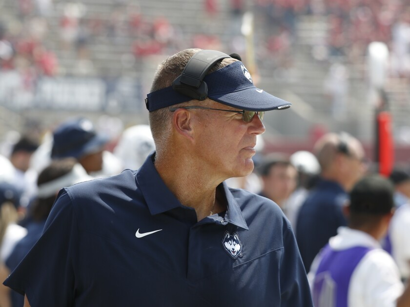 Connecticut coach Randy Edsall watches the team play Fresno State during the second half of an NCAA college football game in Fresno, Calif., Saturday, Aug. 28, 2021. (AP Photo/Gary Kazanjian)