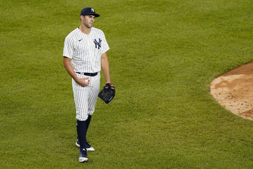 New York Yankees relief pitcher Ben Heller reacts after he was tossed for hitting a batter during the fifth inning of a baseball game against the Tampa Bay Rays, Wednesday, Sept. 2, 2020, at Yankee Stadium in New York. (AP Photo/Kathy Willens)