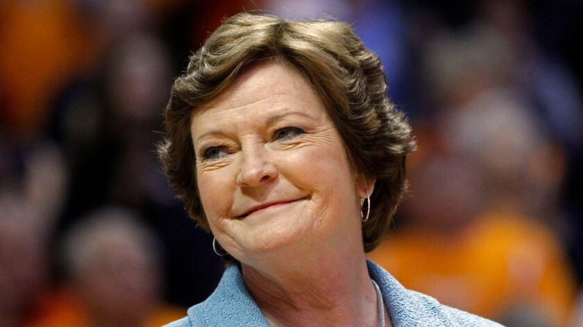 Former Tennessee women's basketball coach Pat Summitt smiles as a banner is raised in her honor before a 2013 game against Notre Dame in Knoxville, Tenn.