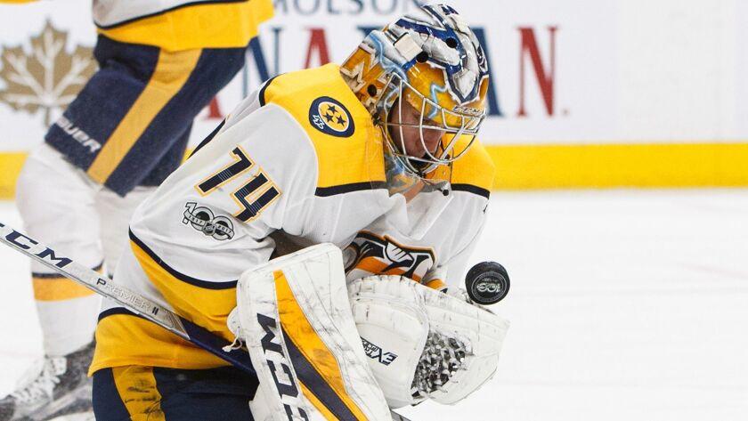 Nashville Predators goalie Juuse Saros makes one of his 46 saves against Edmonton.