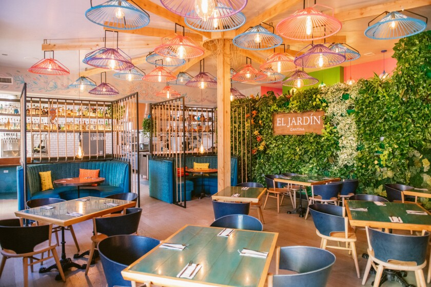 Tweaks to El Jardín Cantina's dining room include adding semi-enclosed booths to add intimacy to the large space. The light fixtures, which all used to be blue, are also now multicolored.