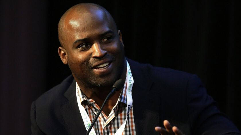 Former NFL player San Diego native Ricky Williams addresses an audience during a conference on medical marijuana at Harvard Medical School on April 11, 2017.
