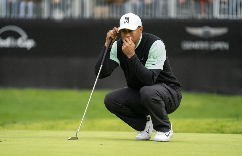 Tiger Woods lines up a putt on the 14th green during the second day of the previously called Genesis Open at Riviera Country Club in 2019.