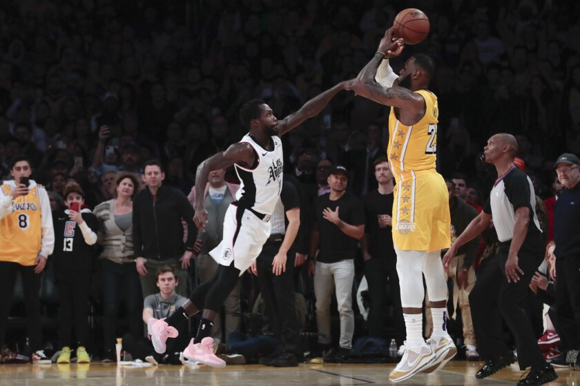 Clippers guard Patrick Beverley causes Lakers forward LeBron James to lose control of the ball with 3 1/2 seconds to play.