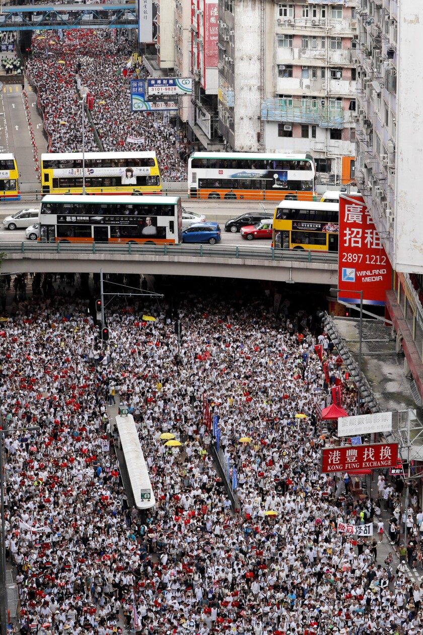 Protesters march in a rally against the proposed amendments to an extradition law in Hong Kong, Sund