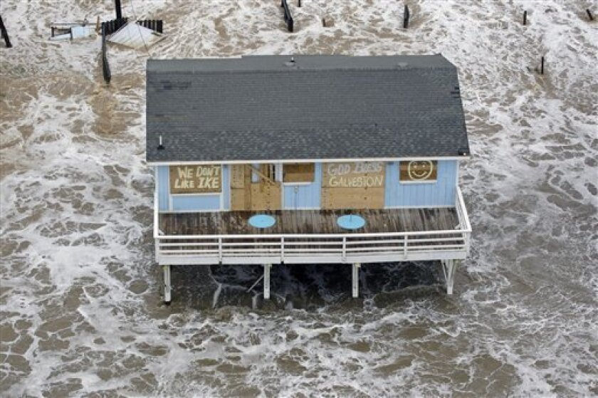FILE - In this file photo taken Sept. 12, 2008, a boarded up home sits along the beach as Hurricane Ike approaches Galveston, Texas. As the 2009 hurricane season arrives Monday, June 1, 2009, many homeowners are finding insurance is either more expensive, or harder to get. (AP Photo/David J. Philli