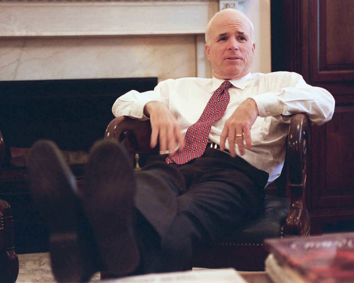 Sen. John McCain relaxes in his office in 1998.