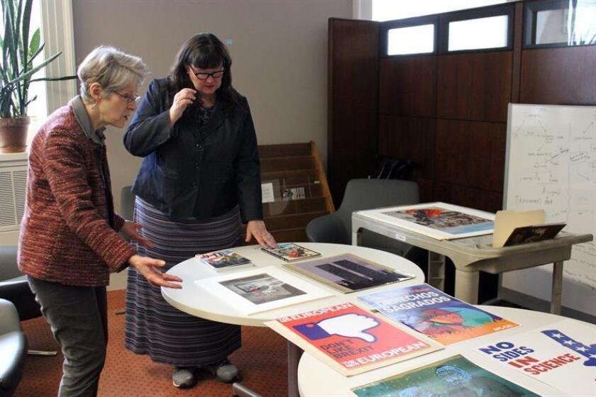 Photo taken Feb. 13, 2019, showing curators with the US Library of Congress in Washington - Martha Kennedy (l) and Katherine blood (r) - discussing some of the posters they and their colleagues have collected for the library recently reflecting current events. EFE-EPA/Rafael Salido