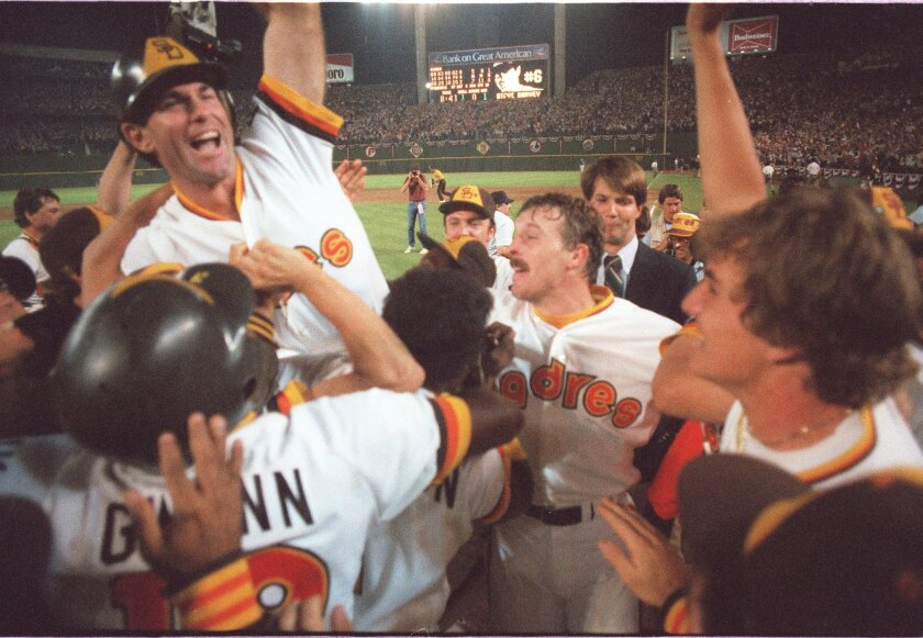 Teammates give Steve Garvey a lift after he gave one to a ball that left the yard in a hurry and left the Padres with hope, sending the 1984 series against the Cubs to a decisive fifth game.
