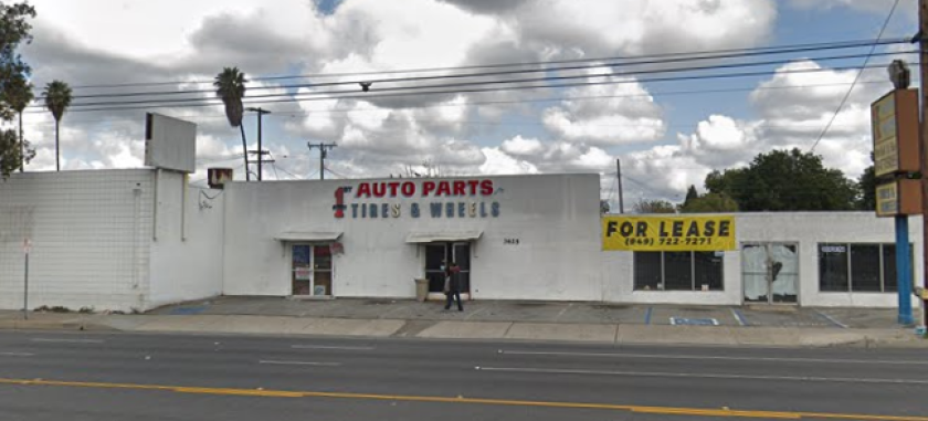 A man with a rifle ran into an auto parts shop in Santa Ana on Tuesday and barricaded himself inside.